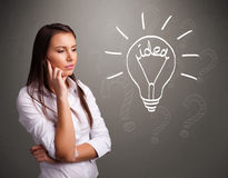 Young girl comming up with a light bubl idea sign Royalty Free Stock Images