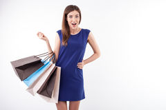 Pretty young girl is crazy about sales Royalty Free Stock Image