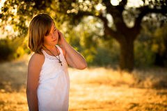 Pretty young girl with cross necklace Stock Photos