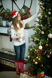 Pretty young girl decorate christmas tree Royalty Free Stock Photos