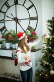 Pretty young girl decorate christmas tree Stock Photos