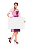 Pretty young girl with dirndl dress holding white board. Young girl with dirndl dress holding white board royalty free stock photography