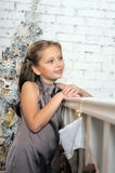 Pretty young girl dreaming of Christmas Royalty Free Stock Photography