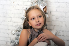 Pretty young girl dreaming of Christmas Stock Images