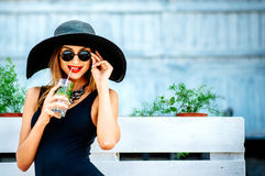 Pretty young girl drink cold coctail outdoor in beach cafe Stock Photography