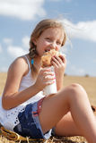 A pretty young girl eating Royalty Free Stock Photography