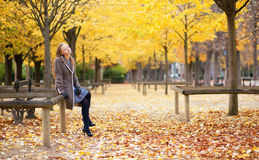 Pretty young girl enjoying a beautiful autumn day Stock Photography
