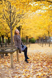 Pretty young girl enjoying a beautiful autumn day Royalty Free Stock Image