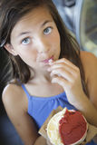 Pretty Young Girl Enjoying Her Gelato Stock Photo