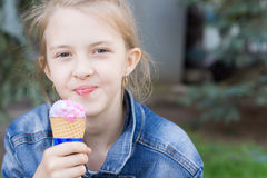 Pretty young girl enjoying an ice cream cone Royalty Free Stock Photography