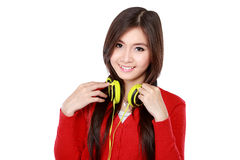 Pretty young girl enjoys listening music Stock Photography
