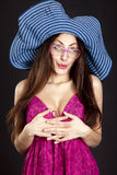 Pretty young girl face in hat and glasses Royalty Free Stock Photography