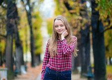 Pretty young girl in a fall park Stock Photography
