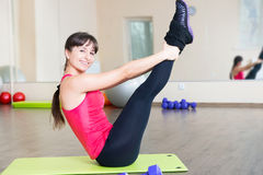 Pretty young girl fitness workout Stock Photography