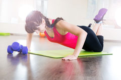 Pretty young girl fitness workout Royalty Free Stock Photos