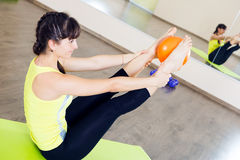 Pretty young girl fitness workout Stock Images
