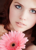 Pretty young girl with a flower Stock Photos