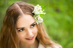 Pretty young girl with flowers Stock Photos