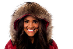 Pretty young girl in fur hood Royalty Free Stock Images