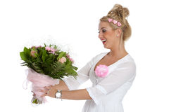 Pretty young girl getting flowers. Beautiful young girl receiving a bunch of pink flowers Stock Images