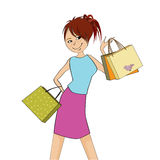 Pretty young girl with gift bags Stock Image