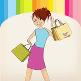 Pretty young girl with gift bags Royalty Free Stock Photo