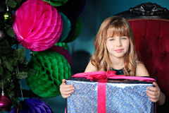 Pretty young girl with a gift Royalty Free Stock Image