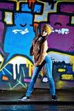 Pretty young girl and graffiti Stock Photo