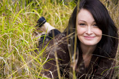 Pretty young girl in the grass royalty free stock images