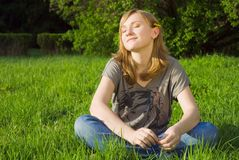Pretty young girl on the grass Royalty Free Stock Photos