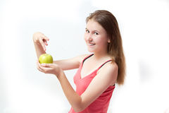 Pretty young girl with a green apple Royalty Free Stock Photo