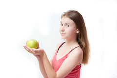 Pretty young girl with a green apple Royalty Free Stock Image