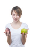 Pretty young girl with green apple Stock Photography