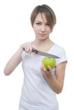 Pretty young girl with green apple and knife Royalty Free Stock Photo