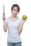 Pretty young girl with green apple and knife Royalty Free Stock Images