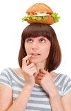 Pretty young girl with hamburger Stock Image
