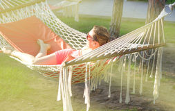 The pretty young girl in a hammock Stock Images