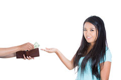 A pretty young girl happily receiving dollars Royalty Free Stock Image