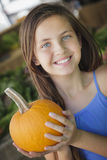 Pretty Young Girl Having Fun with the Pumpkins at Market Royalty Free Stock Photography