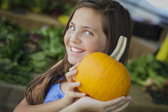 Pretty Young Girl Having Fun with the Pumpkins at Market Royalty Free Stock Images