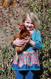 Pretty young girl and hen Stock Photography