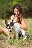 Pretty young girl with her dog Royalty Free Stock Image