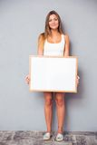 Pretty young girl holding blank board Royalty Free Stock Images