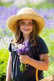 Pretty young girl holding bouquet of lavender Royalty Free Stock Photos