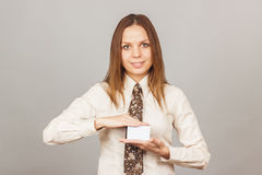 Pretty young girl holding a credit card Stock Photos