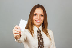 Pretty young girl holding a credit card Royalty Free Stock Photos