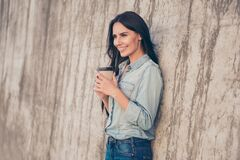 Free Pretty Young Girl Holding Cup Of Coffee Near Stone Wall Stock Images - 175015844