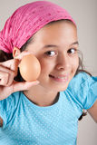 Pretty young girl holding an egg Royalty Free Stock Image