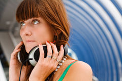 Pretty young girl holding headphones Royalty Free Stock Photos