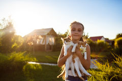 Pretty young girl holding kittens, smiling, looking at camera outside. Royalty Free Stock Photo